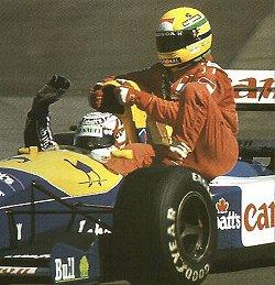 Nigel Mansell gives Ayrton Senna a lift. Image by Eileen Buckley.