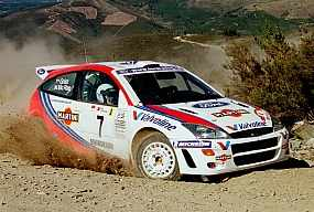 Colin McRae driving his Ford Focus through the famous Arganil stage. Photo: Ralph Hardwick