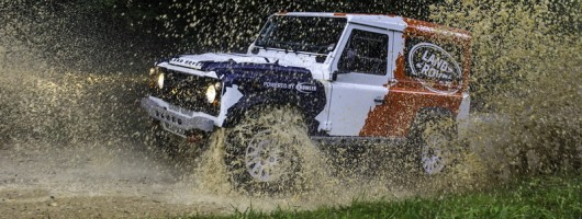 Go Defender racing with Bowler. Image by Land Rover.