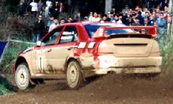 Makinen rushes off into the lead of the rally, and the championship